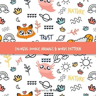 Patrón garabatos coloridos animales y palabras