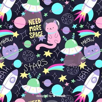 Patrón garabatos coloridos gatos en el espacio y palabras