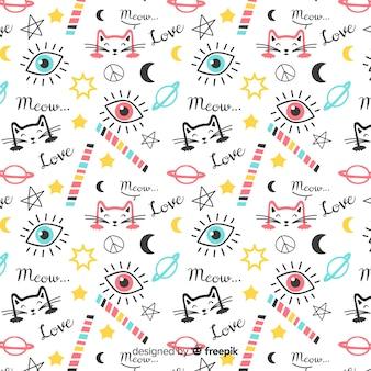 Patrón garabatos coloridos gatos y palabras