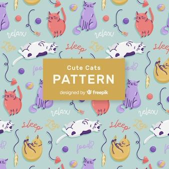 Patrón garabatos gatos y palabras coloridos