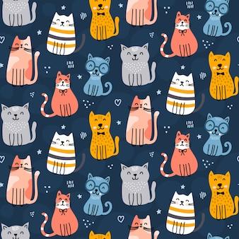 Patrón de gatos lindos sobre fondo azul marino
