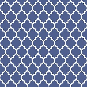 Patrón geométrico en estilo árabe, adorno azul y blanco.