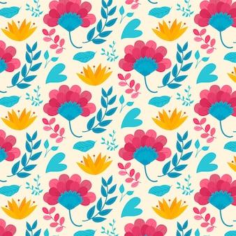 Patrón con hojas y flores exóticas de colores
