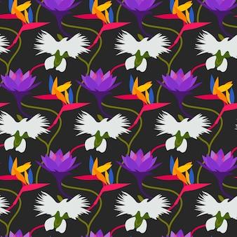 Patrón con hojas y flores tropicales de colores