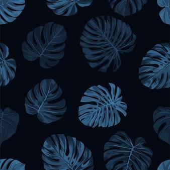 Patrón de índigo oscuro con hojas de palma monstera sobre fondo oscuro. verano sin costuras tropical.