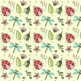 Patrón de insectos y flores dibujados a mano