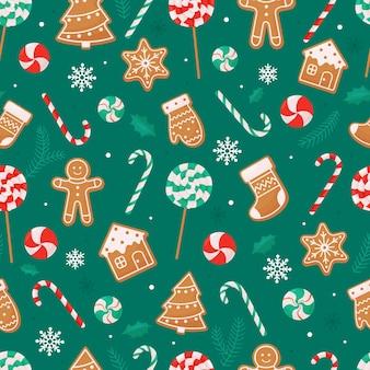 Patrón de navidad sin fisuras con piruletas, galletas de jengibre de bastón de caramelo