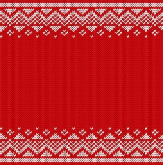 Patrón de navidad tejer sin costuras. adornos de navidad. suéter de invierno de punto. año nuevo fondo rojo con lugar para el texto.