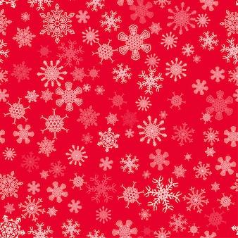 Patrón de navidad transparente rojo con diferentes copos de nieve
