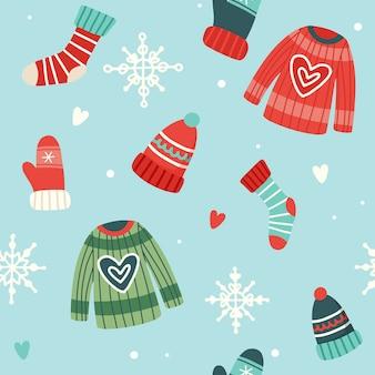 Patrón navideño con lindos suéteres, gorros, calcetines y guantes