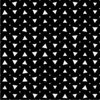 Patrón negro con triángulos y puntos blancos