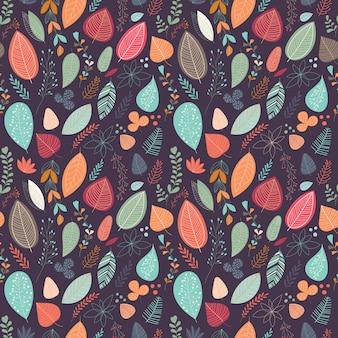 Patrón de otoño con hojas y plantas.