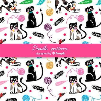 Patrón palabras y gatos dibujado a mano