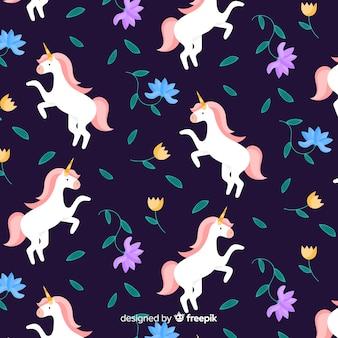 Patrón plano unicornios flotando con hojas