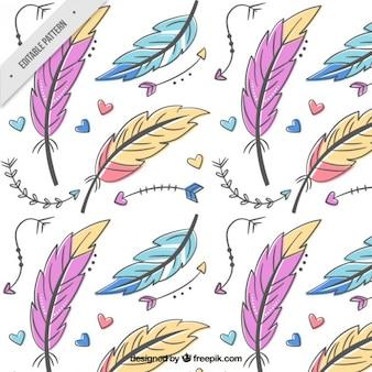Patrón de plumas y flechas de colores dibujadas a mano
