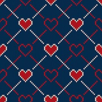 Patrón de punto sin costuras con corazones. fondo de san valentín