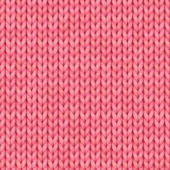 Patrón de punto sin costuras rosa. paño de lana. patrón de punto rojo navideño