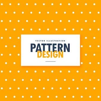 Patrón de puntos blancos sobre un fondo amarillo