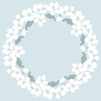 Patrón redondo de la flor de cerezo sobre fondo azul