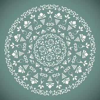 Patrón redondo ornamental con elementos florales