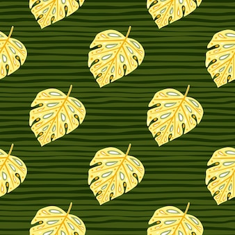 Patrón de selva exótica sin fisuras con estampado de follaje de monstera amarillo claro. fondo de rayas verde oscuro.