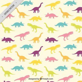 Patrón de siluetas de dinosaurios de colores