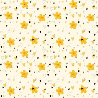 Patrón simple con flores amarillas, corazones negros y puntos.