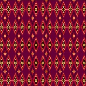 Patrón de songket rojo y marrón