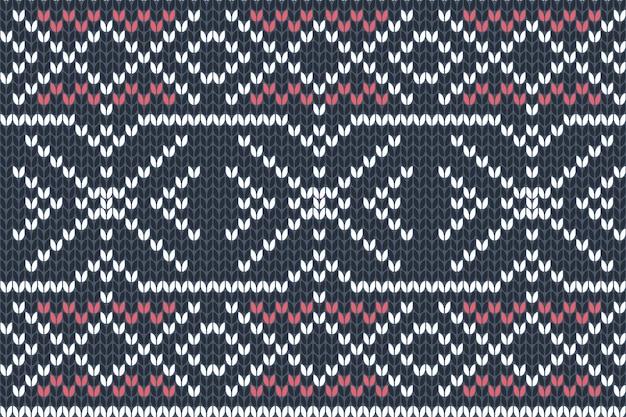 Patrón de tejido sin costuras en colores azul marino, rojo y blanco. diseño de suéter de vacaciones de otoño, navidad e invierno.