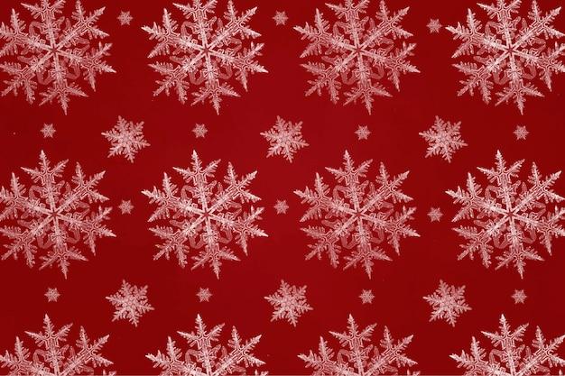 Patrón transparente de copo de nieve de navidad rojo para papel de regalo