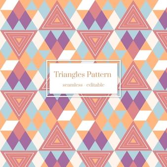 Patrón transparente geométrico de estilo boho con triángulos de colores