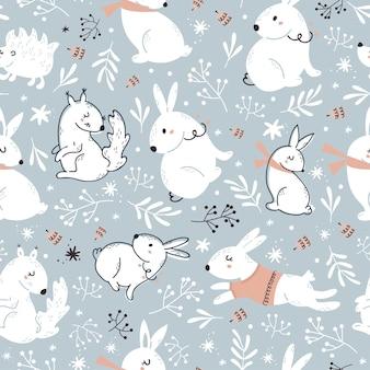 Patrón transparente de navidad azul con lindos animales del bosque.