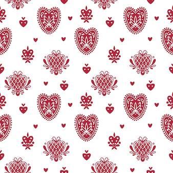 Patrón transparente popular abstracto con corazones y elementos decorativos