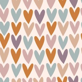 Patrón transparente de vector con corazones de colores.