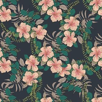Patrón tropical con flores y hojas de hibisco.