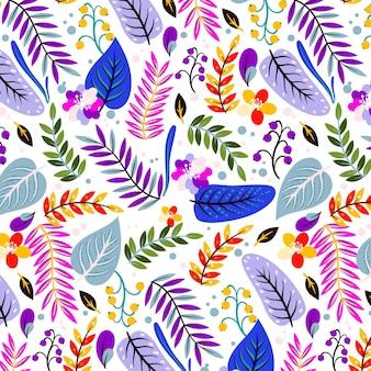Patrón tropical pintado con flores y hojas.