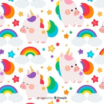 Patrón unicornios coloridos dibujados a mano