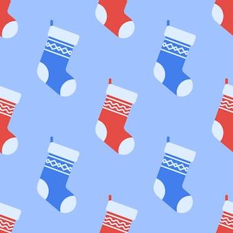 Patrones sin fisuras con calcetines de navidad.