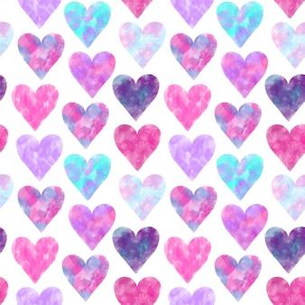 Patrones sin fisuras de corazones de acuarelas rosas y púrpuras