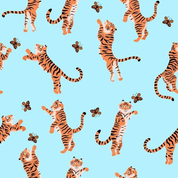 Patrones sin fisuras con tigres jugando con mariposas