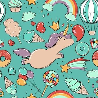 Patrones sin fisuras con unicornio y dulces