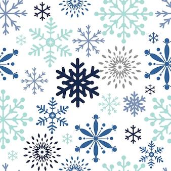 Patrones de navidad sin fisuras con copos de nieve
