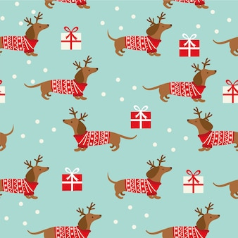 Patrones de navidad sin fisuras con dachshund, copos de nieve y regalos en azul