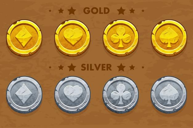 Peak, tref, chirva y pandereta, monedas antiguas de oro y plata simbolos de póker