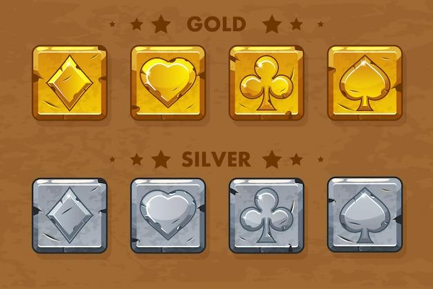 Peak, tref, chirva y pandereta, viejos símbolos de póker dorados y plateados.