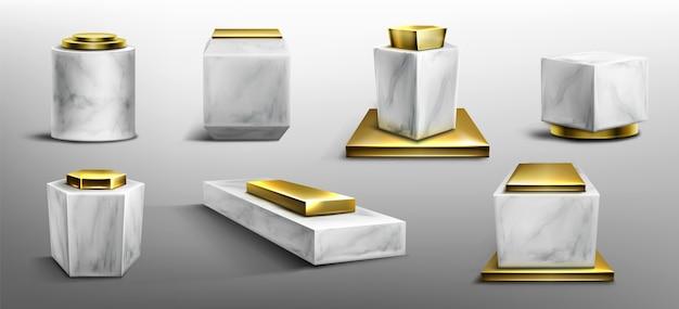 Pedestales de mármol y oro para exhibir productos, exhibiciones o trofeos.