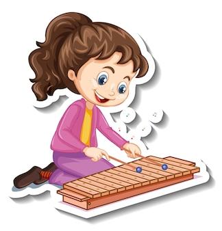 Pegatina de personaje de dibujos animados con una niña tocando el xilófono