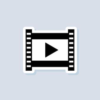Pegatina de reproductor de películas. reproductor multimedia. vector sobre fondo aislado. eps 10.
