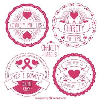 Pegatinas de organización benéfica rosa circulares dibujadas a mano