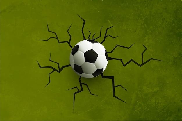 Pelota de fútbol realista con grieta en la pared